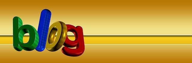 Schriftzug Blog mit bunten Buchstaben auf goldenem Hintergrund